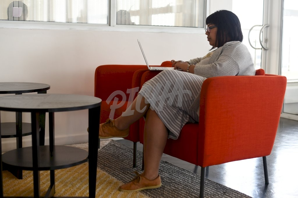 Young professional working on her laptop