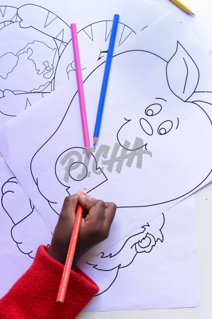 Child coloring on paper