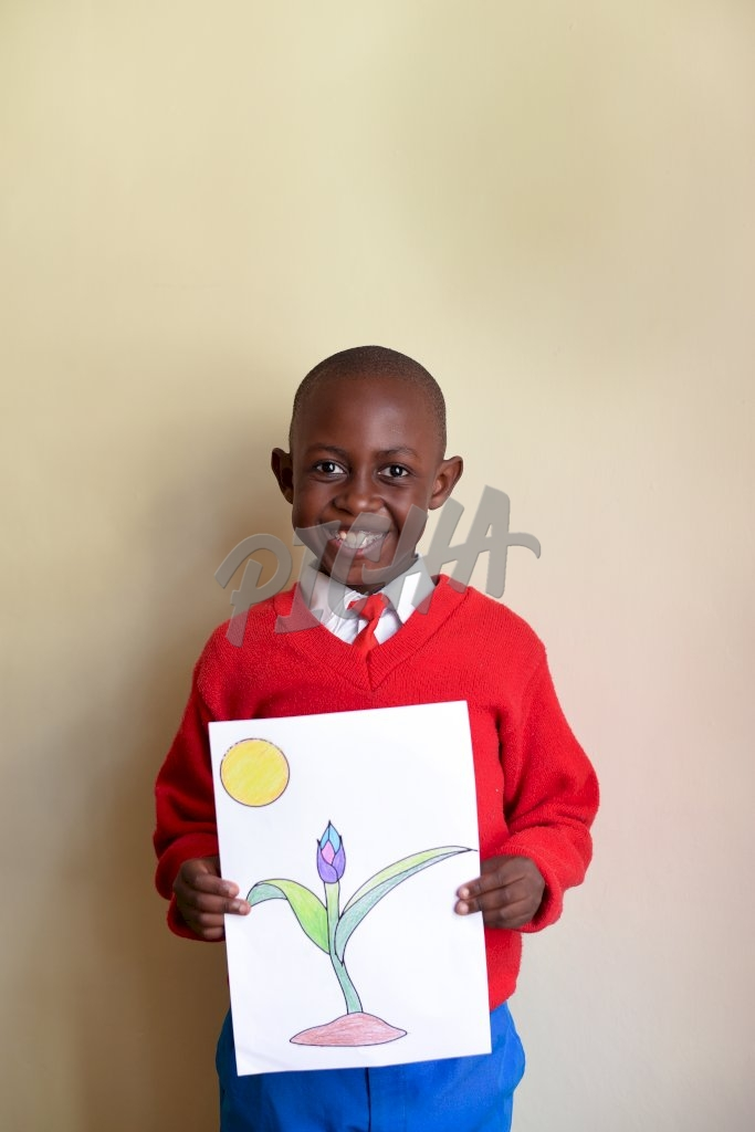 Smiley boy holding a drawing