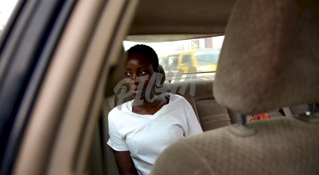 oung woman sitting in the back of a car