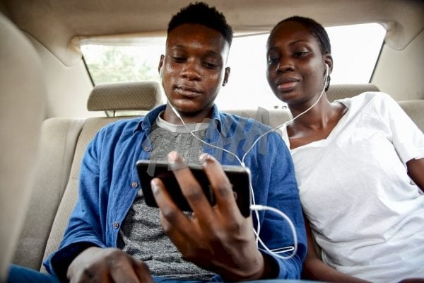 Couple getting entertained on a smartphone