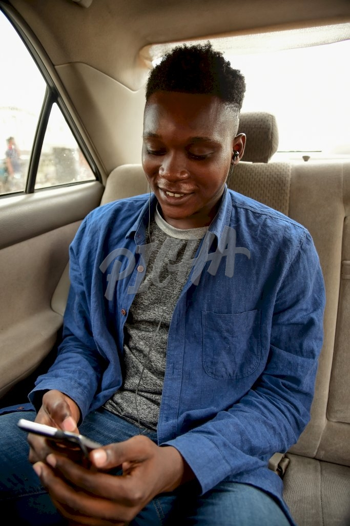 Young Man listening to music in a car