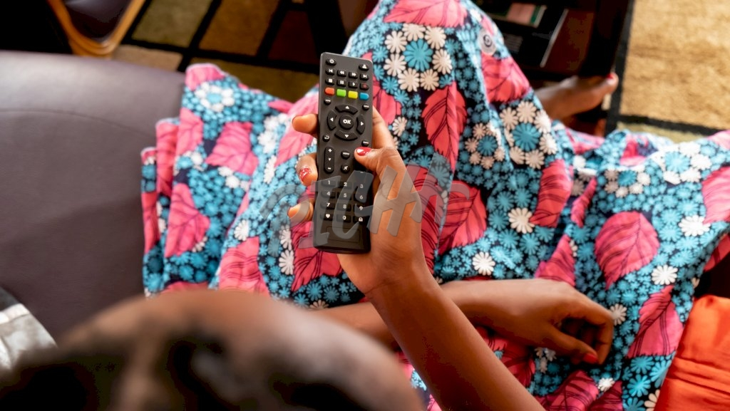 Woman holding a remote