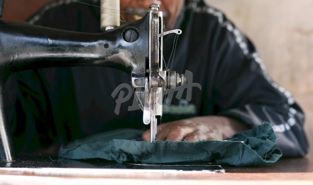 Working the sewing machine