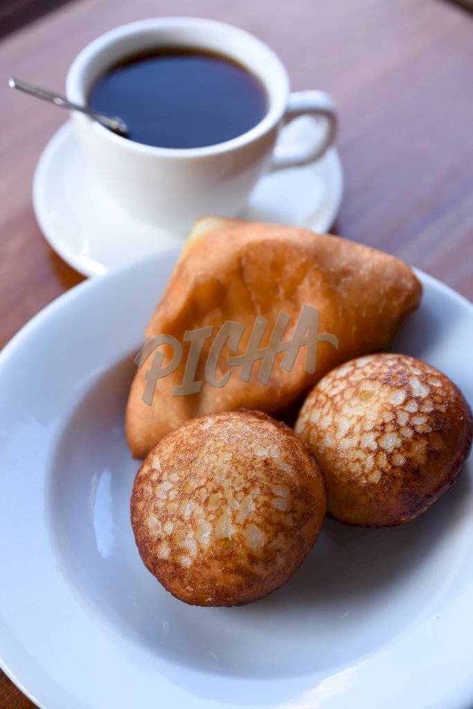 Fried cakes and a coffee