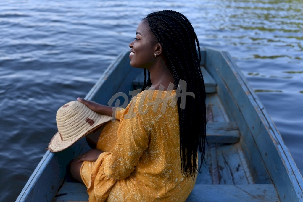 young woman sitting on a boat