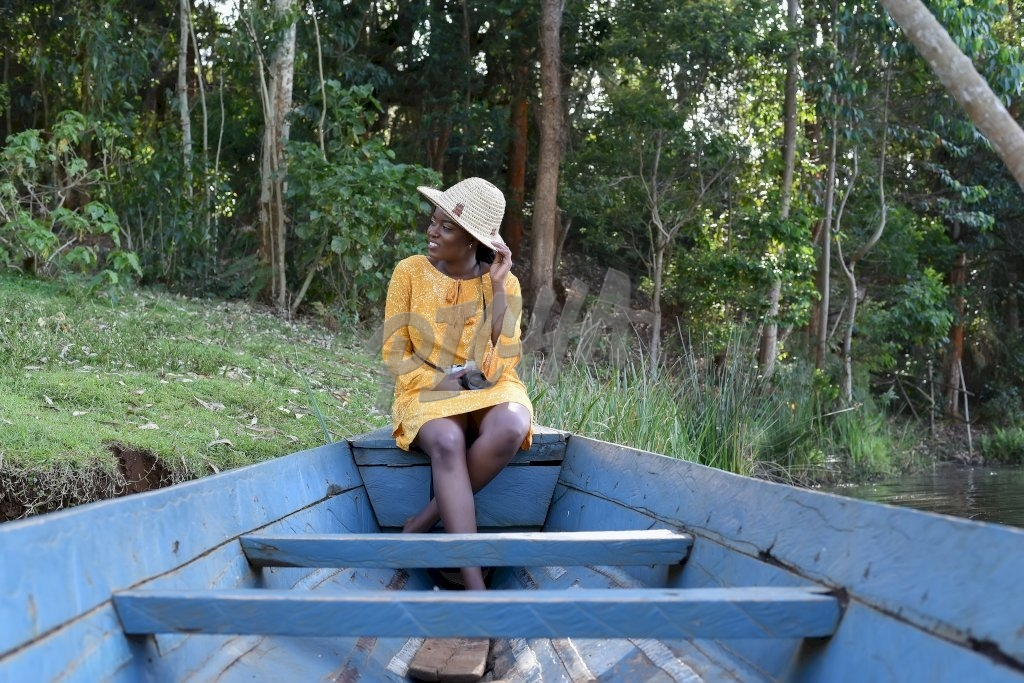 young woman sitting in a boat