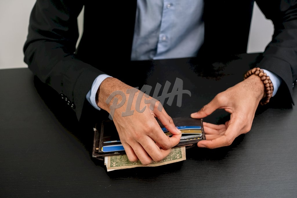 Pulling credit card from wallet