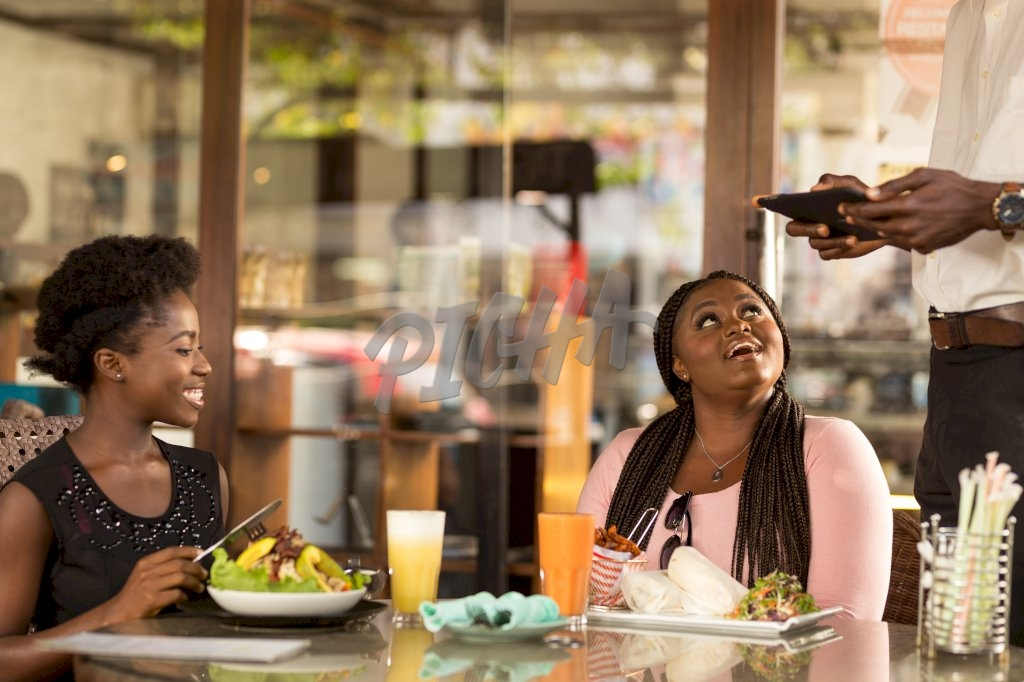 clients share a light moment with the attendant while having their meal