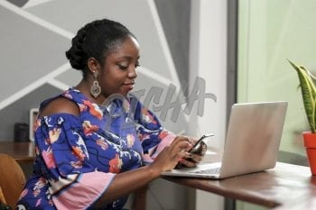 young woman checking her phone at work