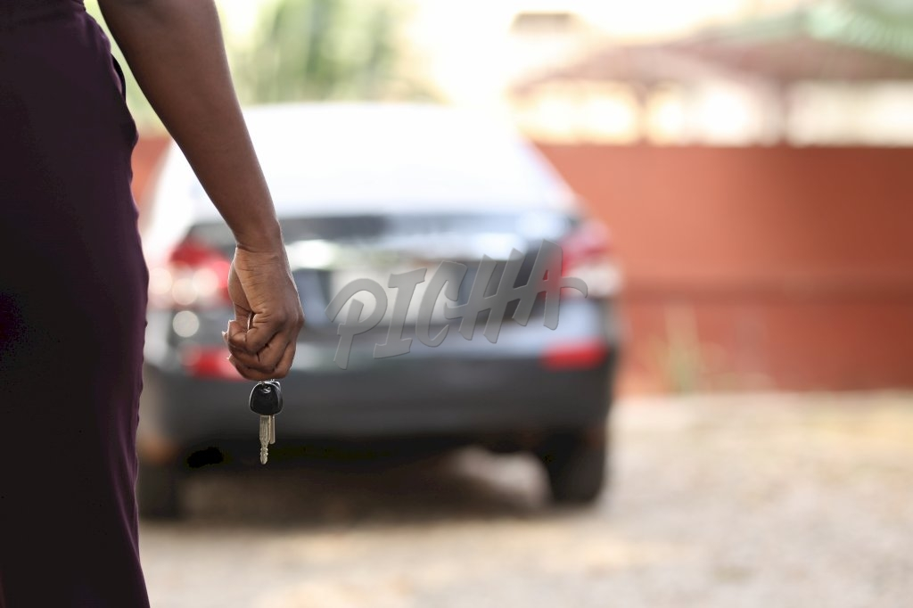holding keys to the car