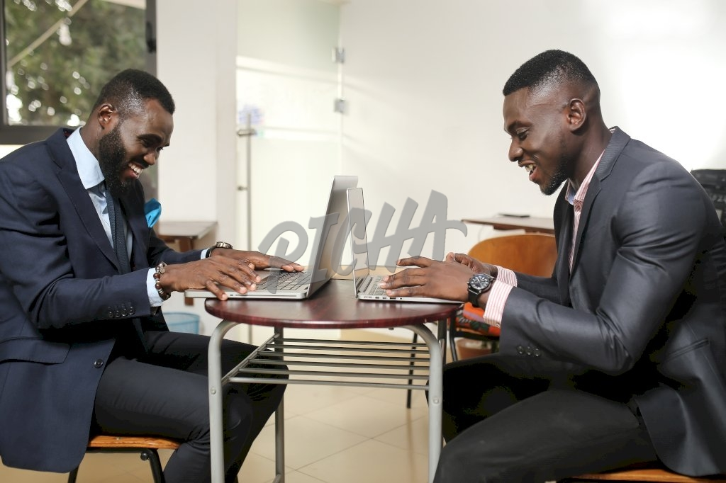 Young professional men happy at work