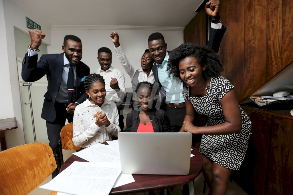 Group of smart professional youth excited at work