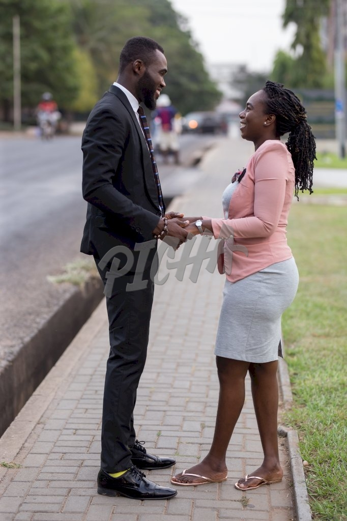 Smart Man and woman hold hands in the street