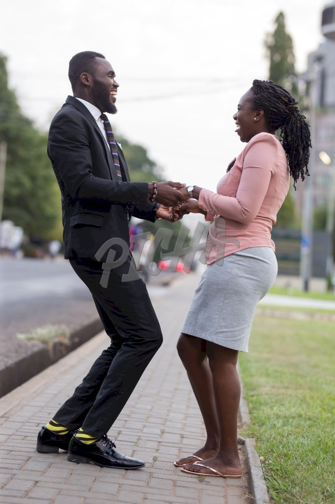 Smart Man and woman hold both hands in the street