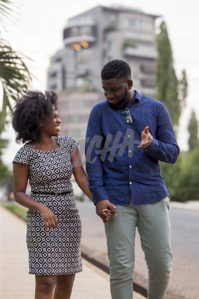 Young couple chat happily down the street