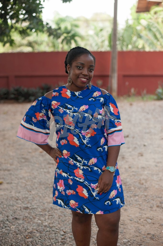 cute African lady in a blue floral dress