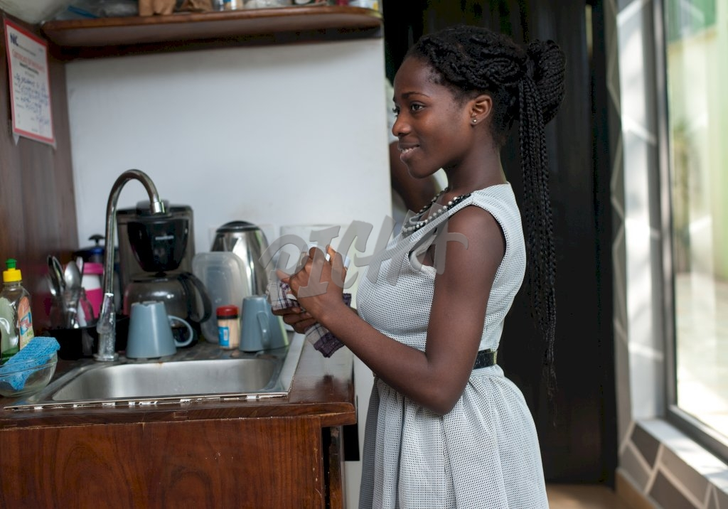 Woman in white dress standing in the kitchen