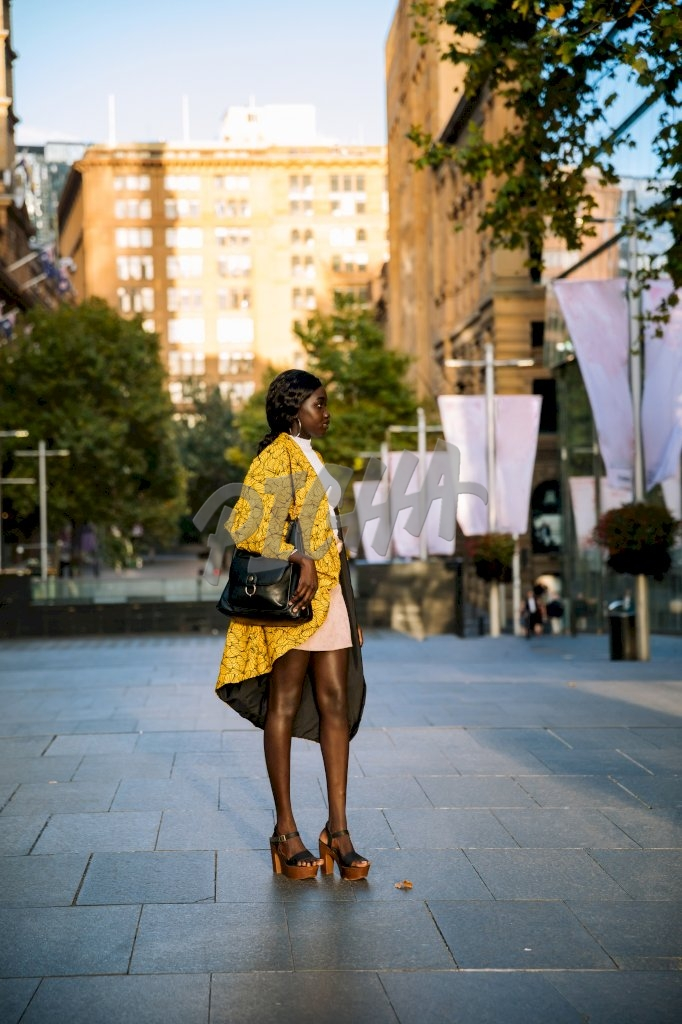 smart young lady standing in yellow kimono