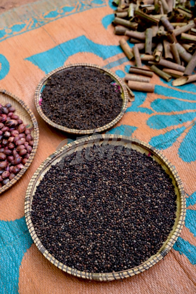 peppercorns in a woven tray