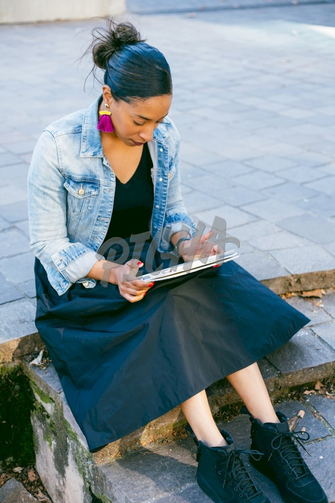 Woman reading on her tablet