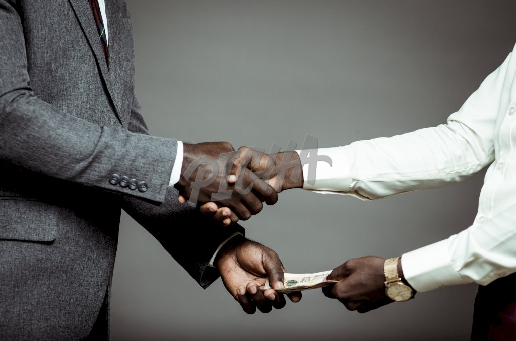 Handshake with an exchange of money