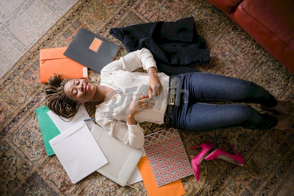 Woman on the floor overwhelmed with work
