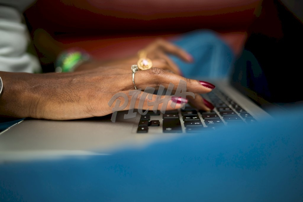 Woman typing on her laptop
