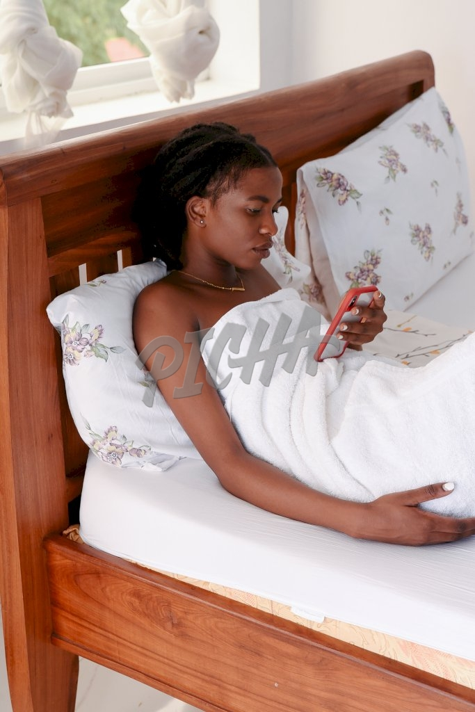 Using a cellphone on the bed
