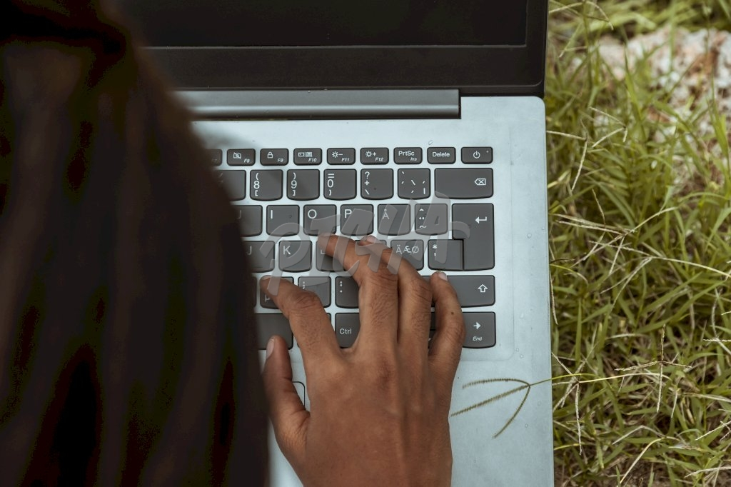 Using a laptop on the grass