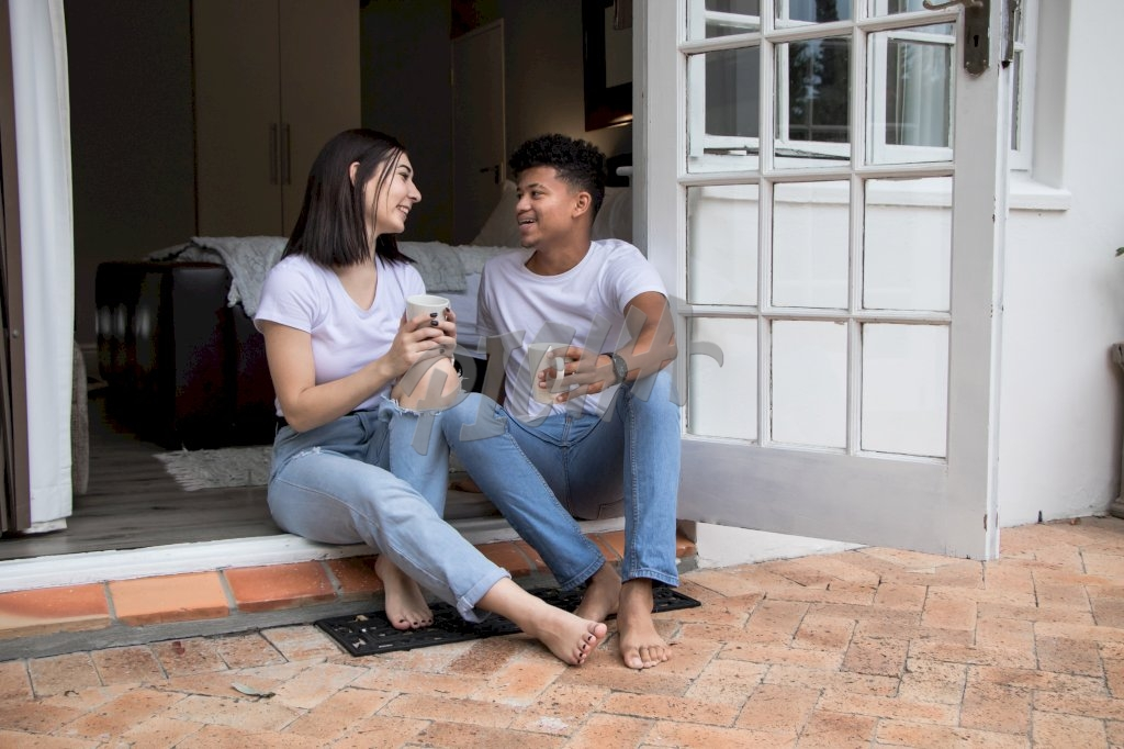 couple enjoy coffee and a light chat while seated by their room entryway