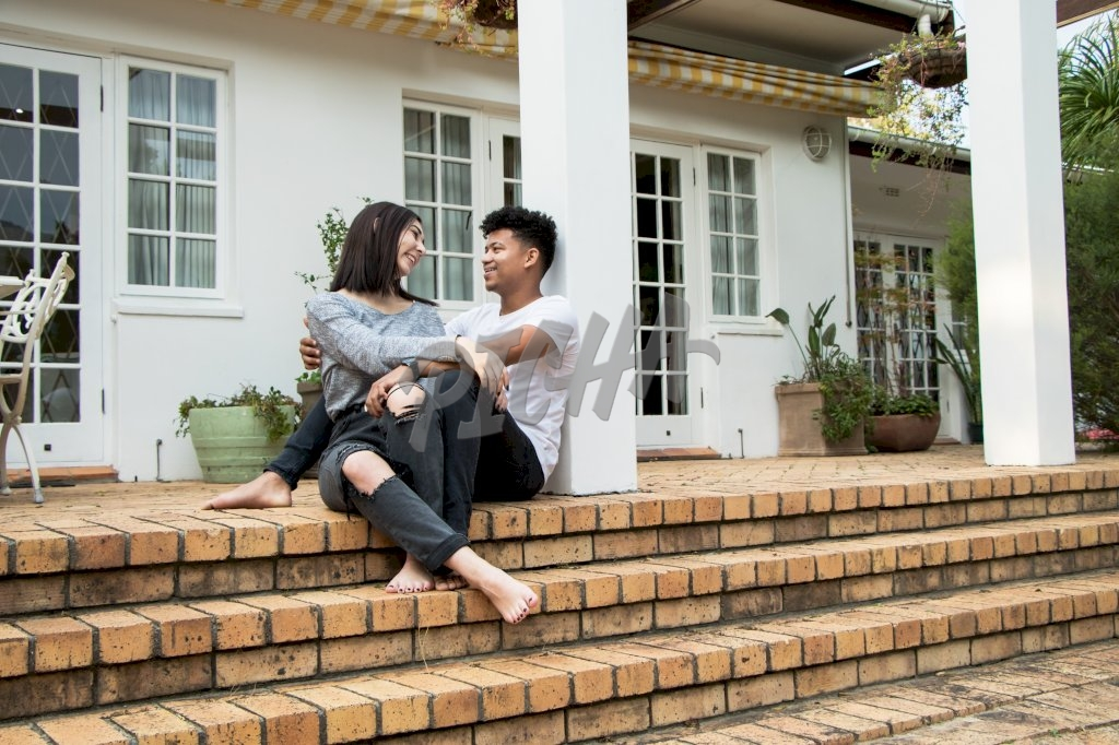 couple share some light moments outside the house