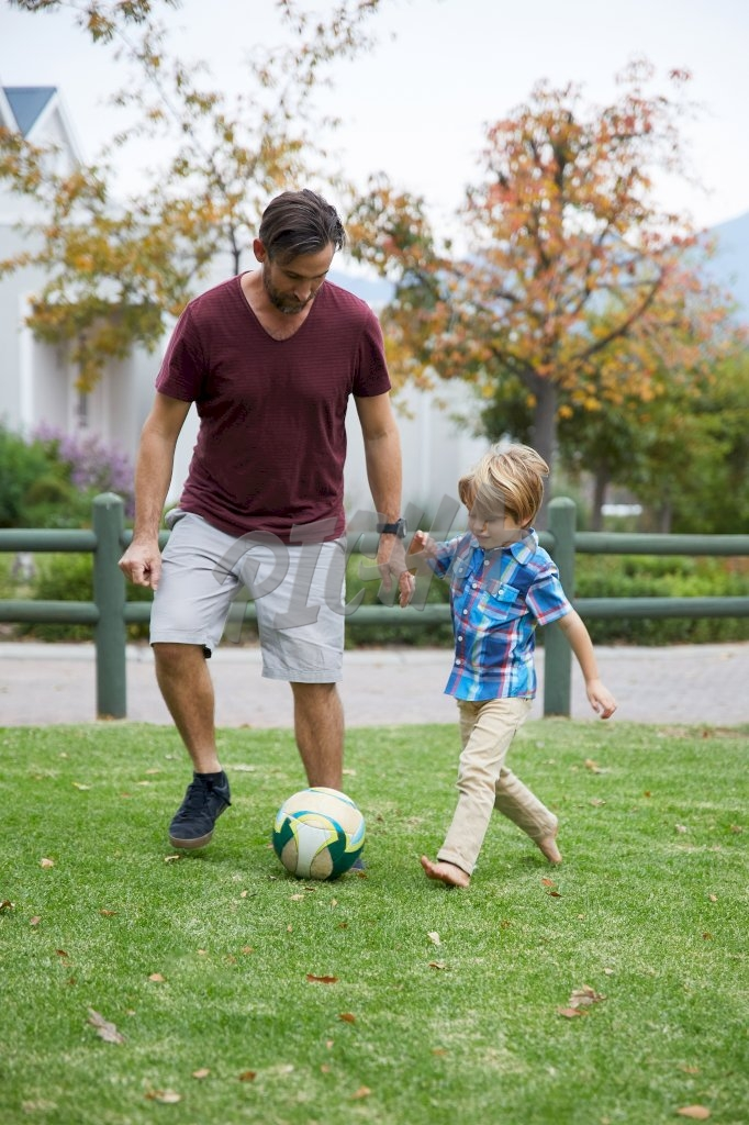 Father and son kick-about