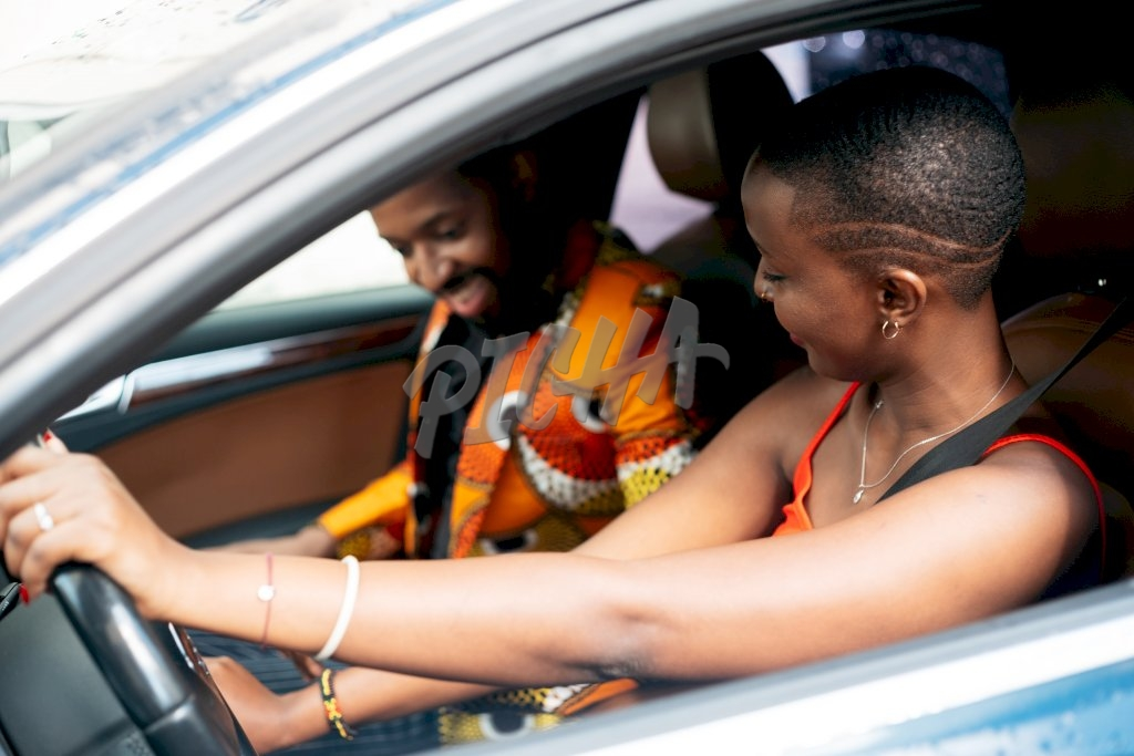 young man and woman share a light moment during a drive