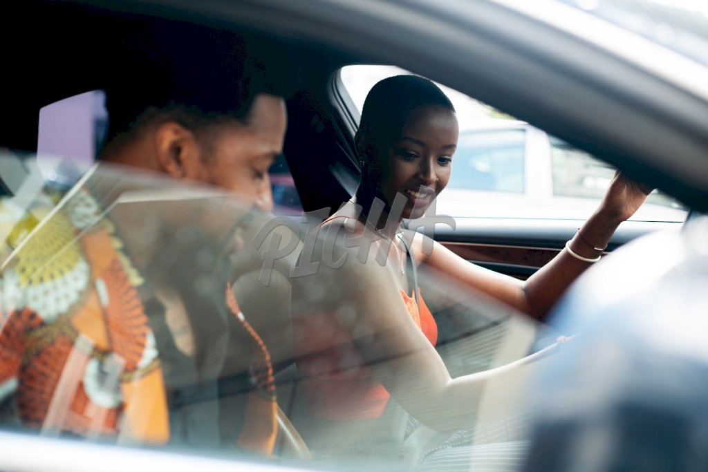 young man and woman in a car
