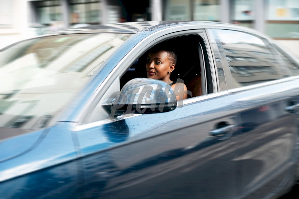 lady driving past in a saloon vehicle
