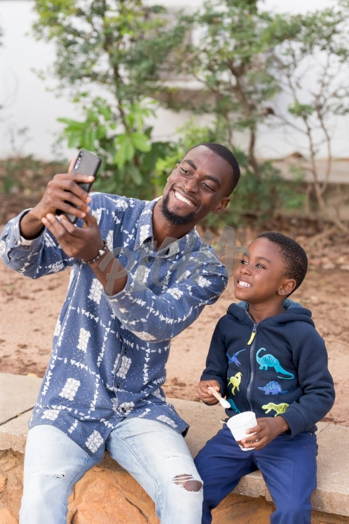 Father and son having a good timeFather and son taking a selfie