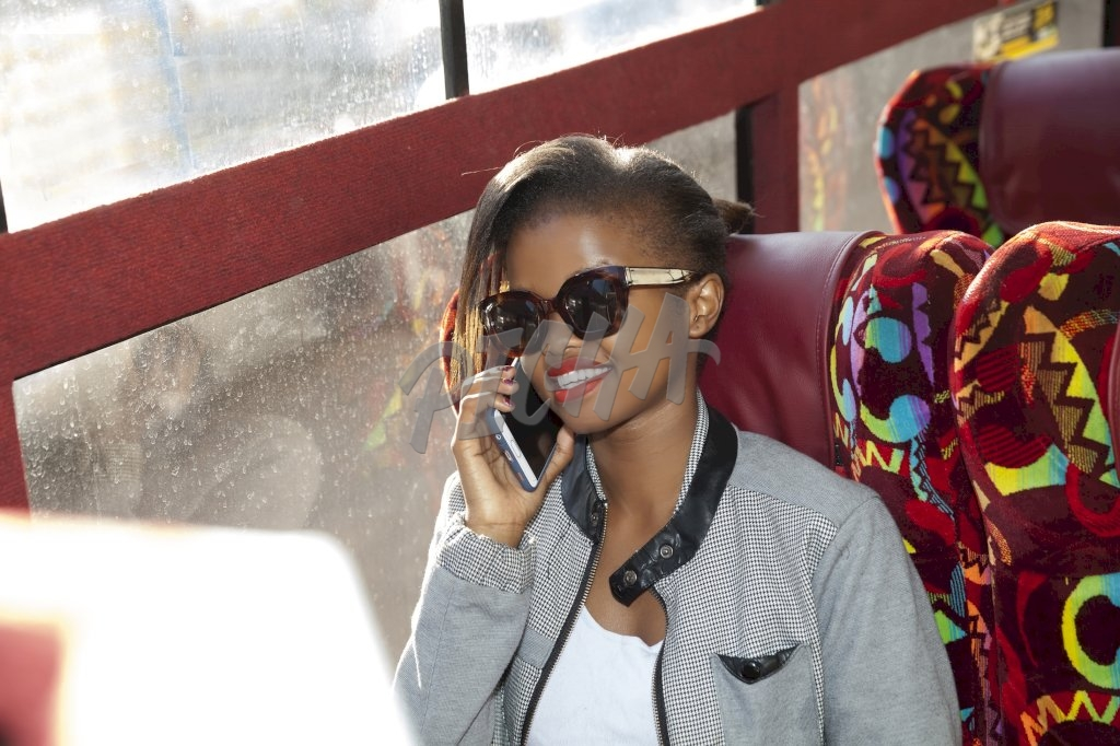 Young woman sitting on the bus on the phone