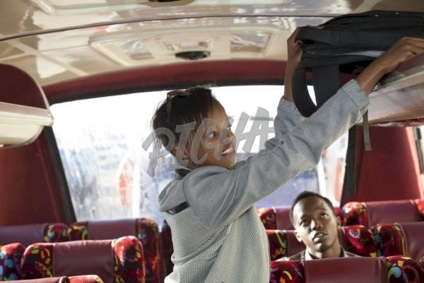 Young woman on the bus holding backpack