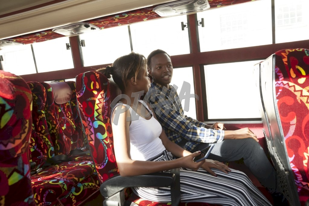 Young woman and young man sitting on the bus