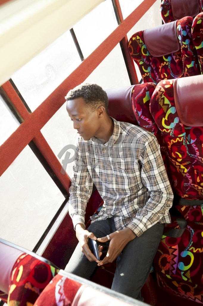 Young man sitting on the bus