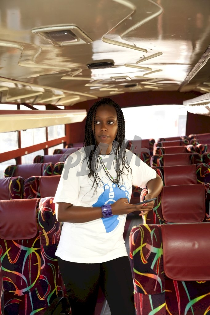 Woman standing on the bus
