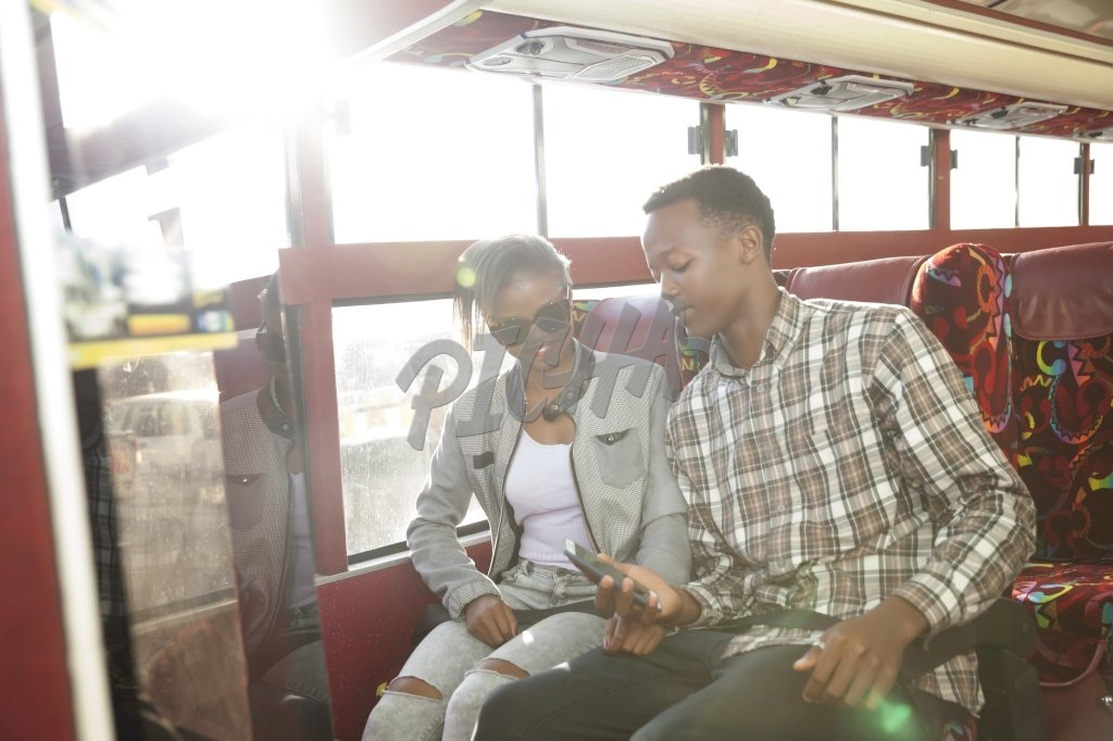 Young man and woman sitting on the bus