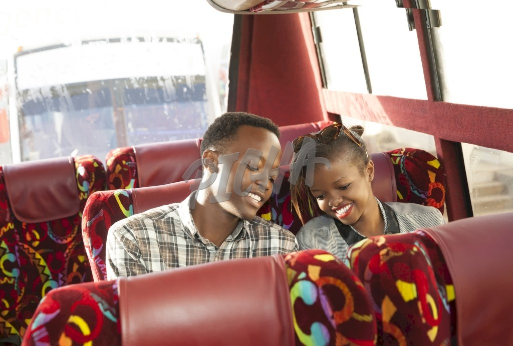 Young man and young woman sitting on the bus