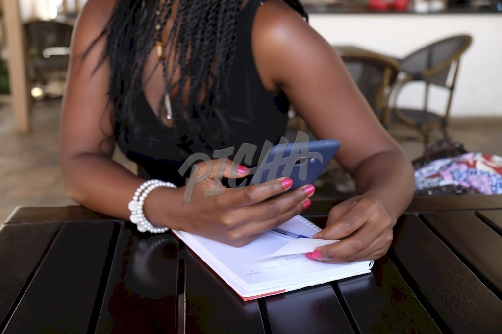 woman working with mobile phone