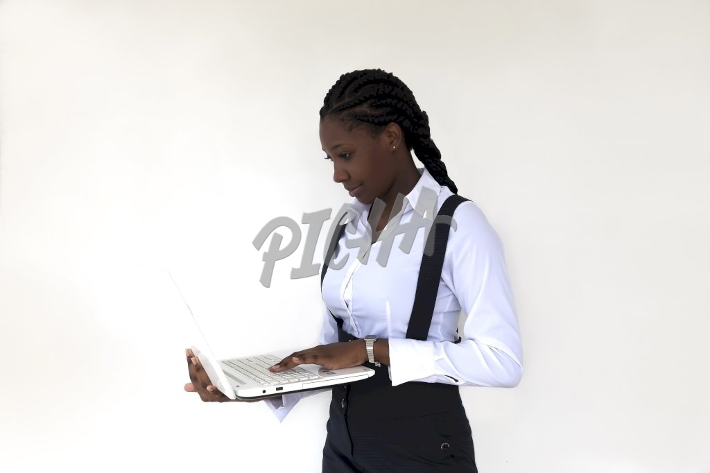 Woman standing with white laptop