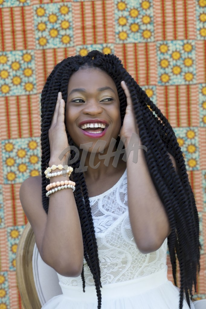 Braided woman laughing