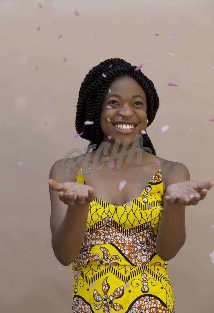 woman smiling with confettis