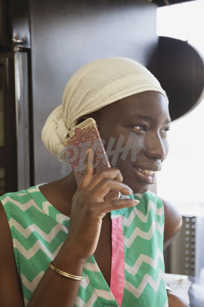 Woman with scarf on phone