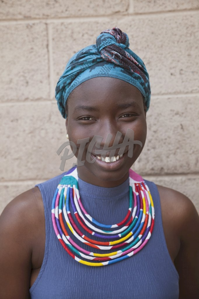 Woman wearing a scarf smiling